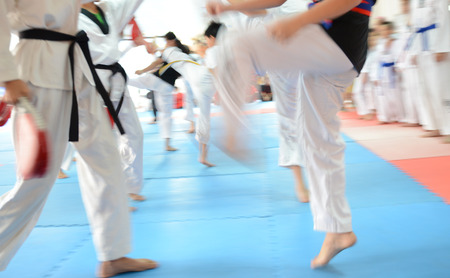 black belt: People in martial arts training exercising Taekwondo. blur motion Stock Photo