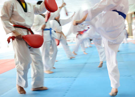 People in martial arts training exercising Taekwondo. blur motion Archivio Fotografico