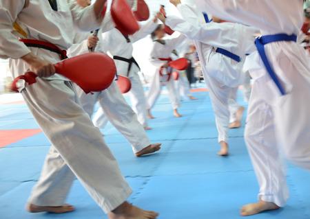 People in martial arts training exercising Taekwondo. blur motion Standard-Bild
