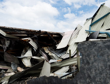 house demolition: old ruined buildings of metal warehouse. Stock Photo