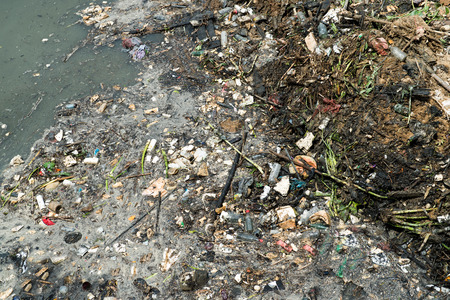 water pollution: Water pollution in river with trash.