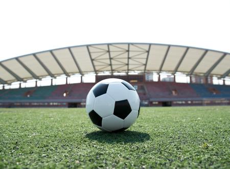 sporting: Soccer ball in front of the goal door.