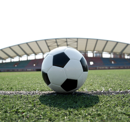 football match lawns: soccer ball on stadium grass line. Stock Photo