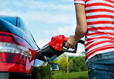 refuel: Hand refilling the car with fuel.