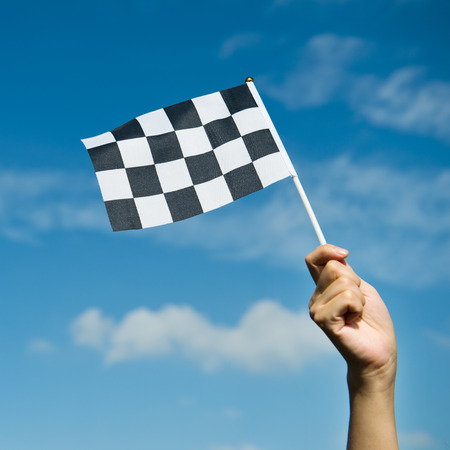 chequered: checkered race flag in hand.