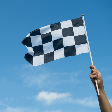 end of the line: checkered race flag in hand.