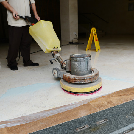 buffing: People cleaning floor with machine.