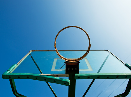 Basketball hoop against blue sky. Stock Photo