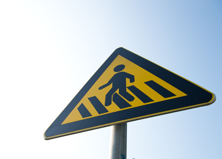 cross walk sign against blue sky. photo