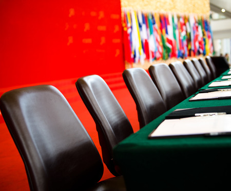 conference room table: Conference table and chairs in meeting room