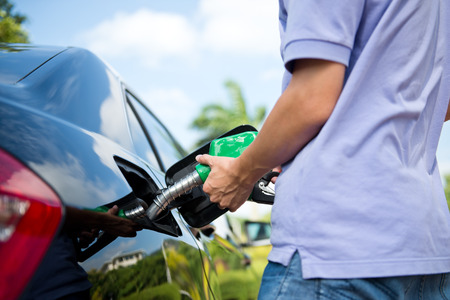 refilling: Hand refilling the car with fuel.