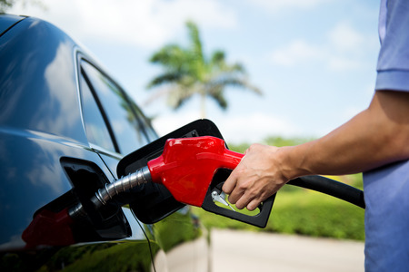 pumping: Hand refilling the car with fuel.