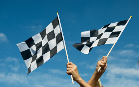 checkered flag: checkered race flag in hand.