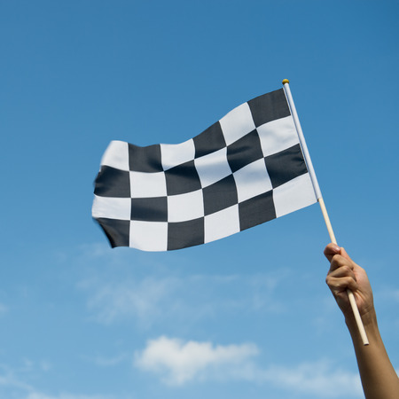 formula one car: checkered race flag in hand.