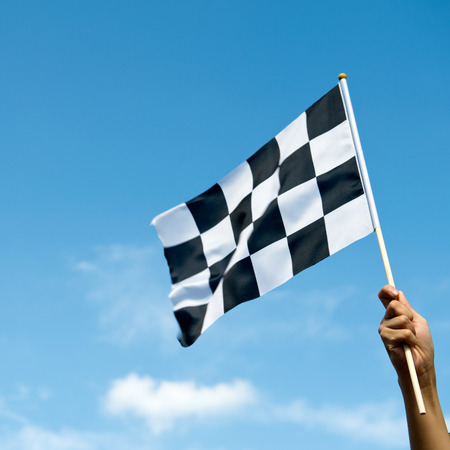race: checkered race flag in hand.
