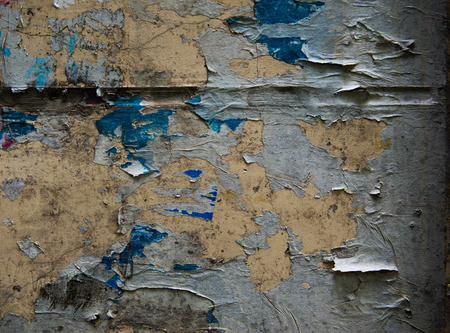 old torn posters on grunge wall photo