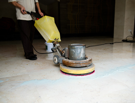 People cleaning floor with machine. Banco de Imagens - 33783855