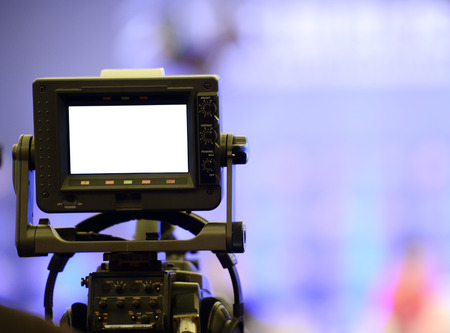 filming: Live broadcasting, television operator with camera.