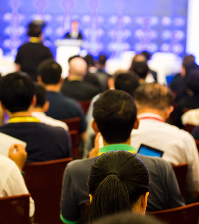 Rear view of business people listening attentively at conference. Imagens - 33784693