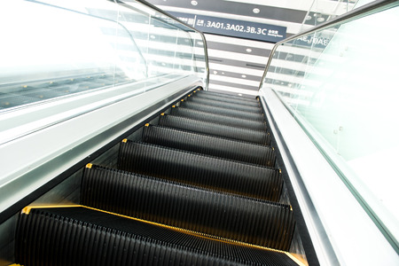 perspective room: escalator in new modern building. Stock Photo