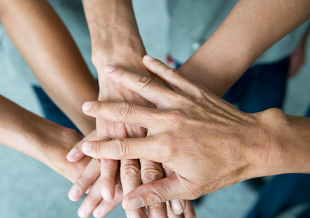 work together: People with their hands together. team work concept Stock Photo