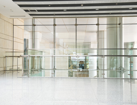 hall: modern interior with glass wall in an office building.