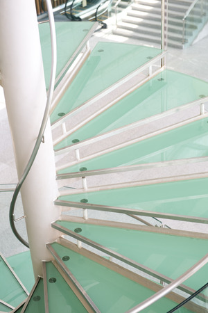 metal handrail: modern glass staircase in a conference center.