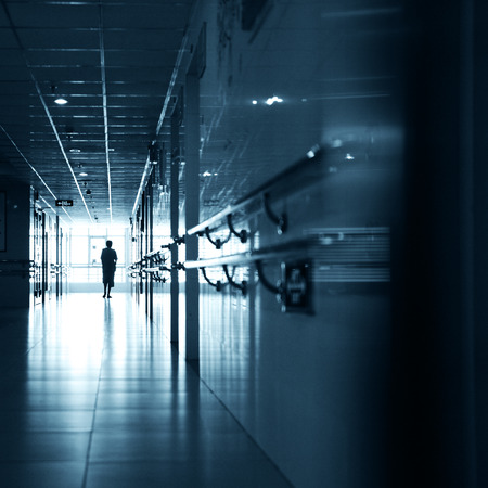shadow: People walking through the hospital corridor. Stock Photo