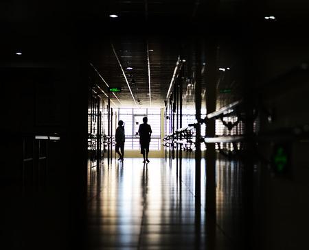 People walking through the hospital corridor. photo