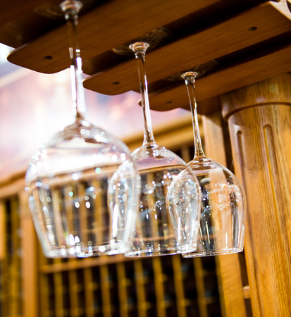 glassware: Group of wine glasses hanging on the rack