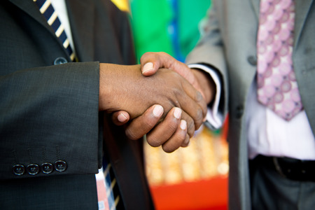 acknowledge: African businessmans hand shak making a business deal. Stock Photo