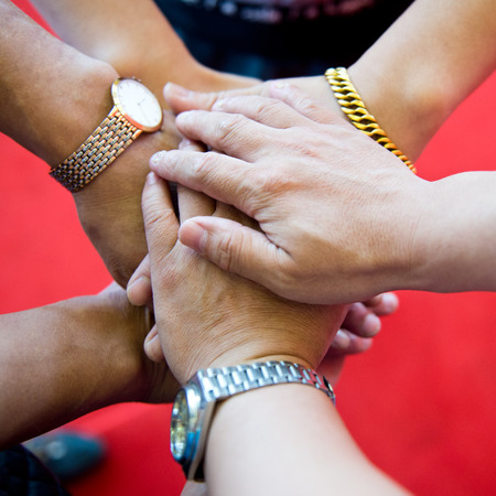 joining hands: People with their hands together. team work concept Stock Photo