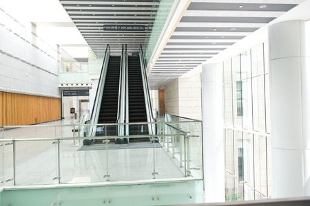 metal handrail: escalator in new modern building. Editorial