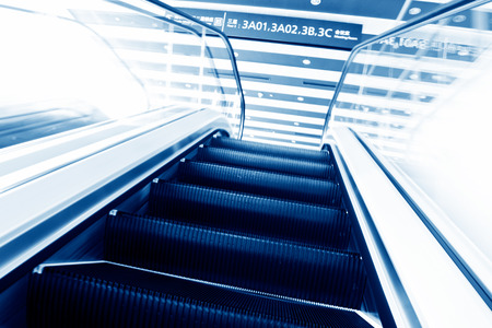 low glass: escalator in new modern building. Stock Photo