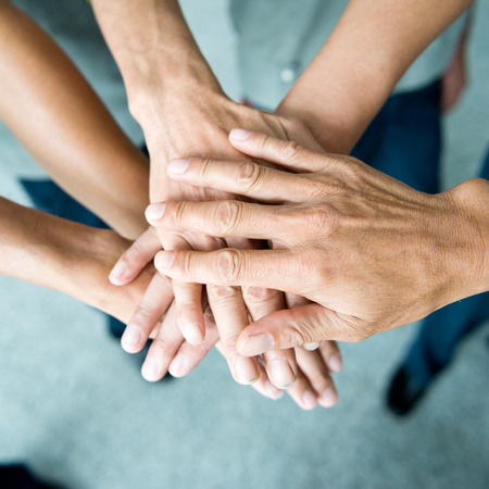 join the team: People with their hands together. team work concept Stock Photo