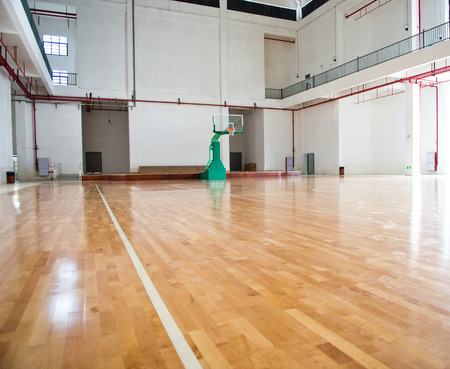 high school basketball: basketball court, school gym indoor.