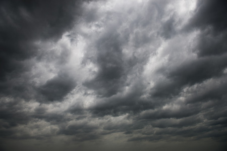 Background of dark clouds before a thunder-storm. 스톡 콘텐츠