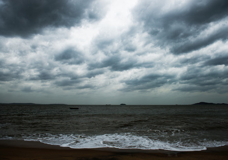 View of storm seascape with dark clouds. photo