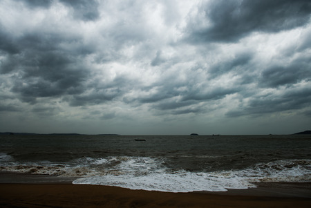 View of storm seascape with dark clouds.