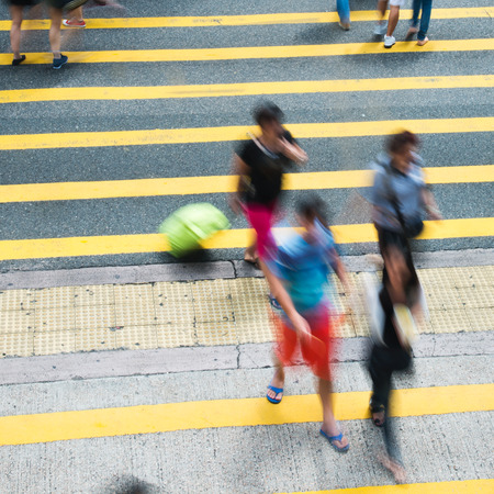 crossing street: Busy city people on zebra crossing street in Hong Kong, China.