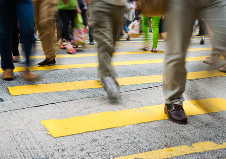 zebra crossing: Busy city people on zebra crossing street in Hong Kong, China.