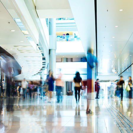 People rushing in the lobby. motion blur 報道画像