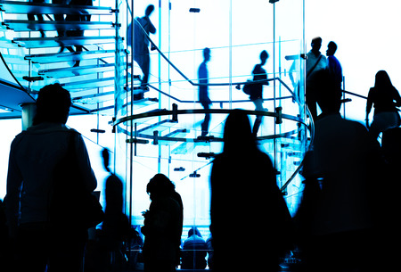 Silhouette people on glass staircase photo