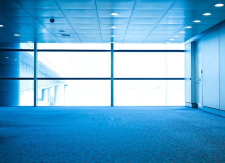 blue carpet: empty hall in the modern office building.