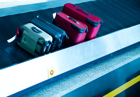 conveyor belt: suitcases on conveyor belt of airport. Stock Photo