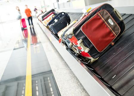 suitcases on conveyor belt of airport. Standard-Bild