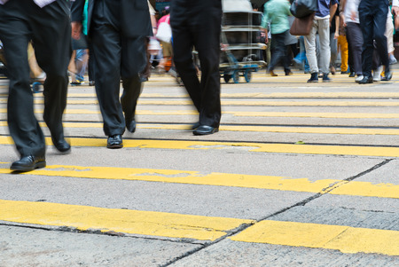 city people: Busy city people on zebra crossing street in Hong Kong, China.