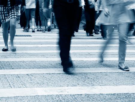 pedestrian crossing: Busy city people on zebra crossing street in Hong Kong, China.