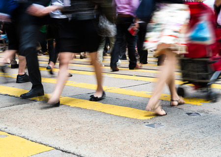crossing street: Busy city people on zebra crossing street in Hong Kong, China.
