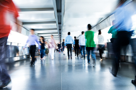 crowds': People rushing in the lobby. motion blur Stock Photo